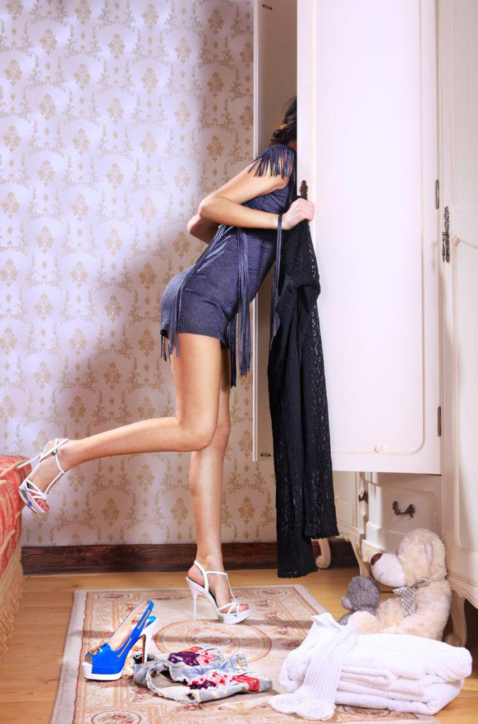 woman near sliding-door wardrobe
