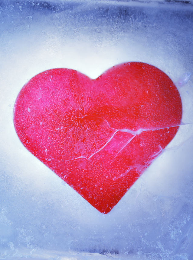 A Red heart frozen in a block of ice